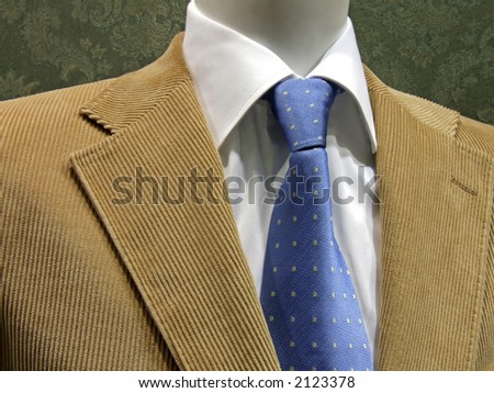 Blue tie with shirt and velvet suit - stock photo