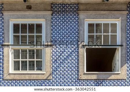 Blue tile decoration in a Porto window. - stock photo