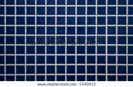 Blue tiled wall in the bathroom - stock photo