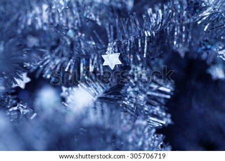 Blue tinsel Christmas decoration - close-up photo - stock photo