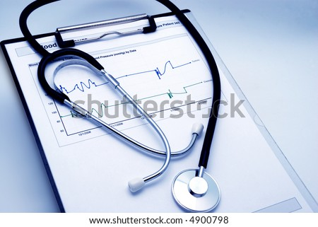 Blue tint Stethoscope on clipboard over blood pressure graph printout - stock photo