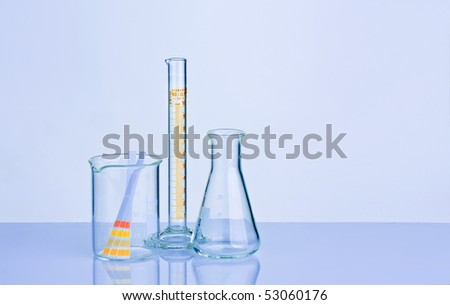 Blue tone chemistry lab containers and PH indicator
