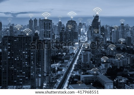 blue tone city scape and wifi network connection concept  - stock photo