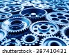 Blue tone of metal cog wheels close up.selective focus - stock photo