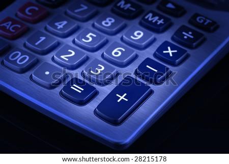 Blue toned image of desktop calculator keypad. Black background. - stock photo