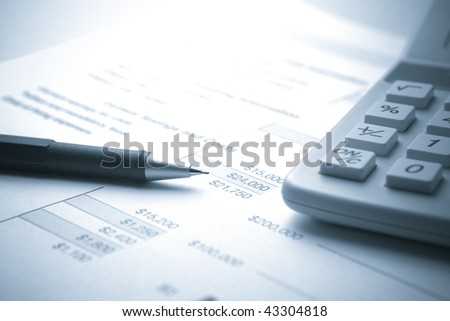 Blue Toned image of Financial Document with Pencil and Calculator - stock photo