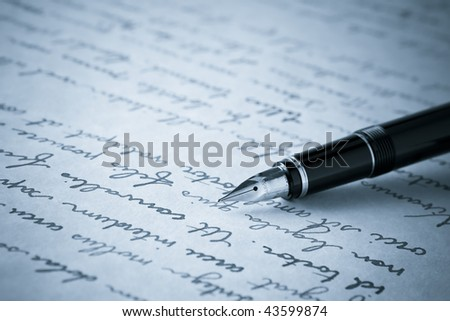 Blue Toned Image of Gold Fountain Pen on Written Page. Crisp focus on nib of pen. - stock photo