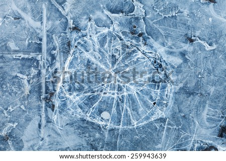 Blue toned macro background texture of broken ice surface - stock photo