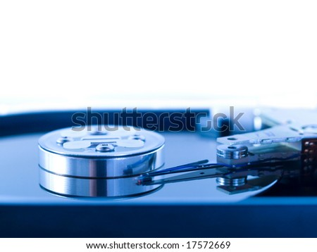 blue toned macro of an open hard drive disk - stock photo