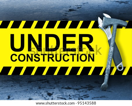 Blue toned under construction board with construction right tools - stock photo