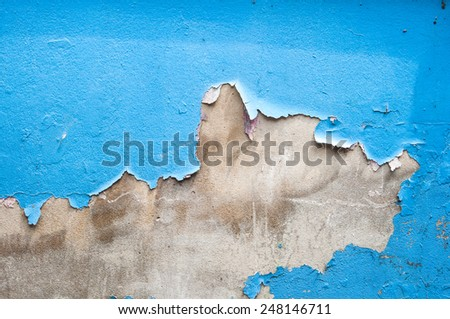 Blue tones texture of shabby paint and plaster cracks on cement wall - stock photo