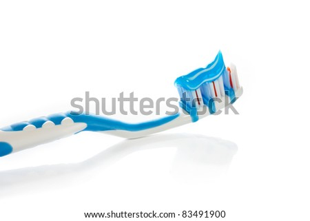 Blue toothbrush isolated on white background - stock photo