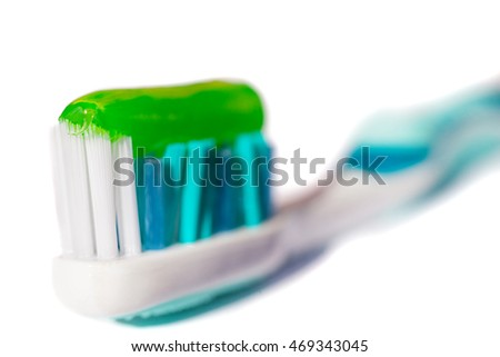 Blue toothbrush with green toothpaste isolated on a white background