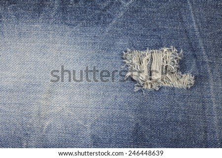 Blue torn denim jeans texture - stock photo