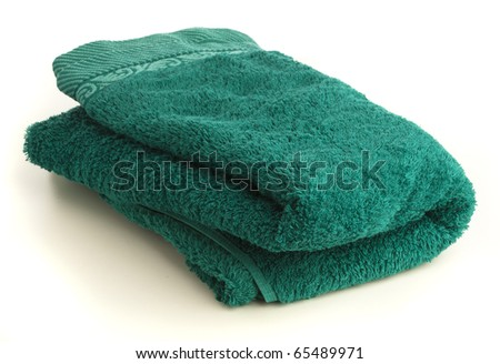 blue towel isolated on a white background - stock photo