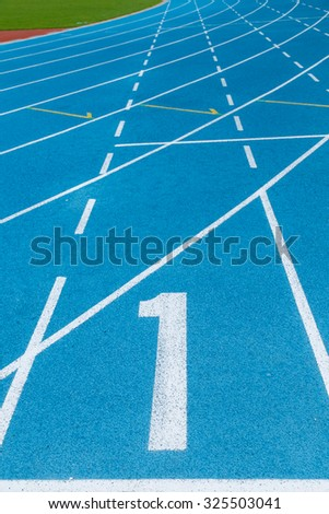 Blue track with white line at first line.