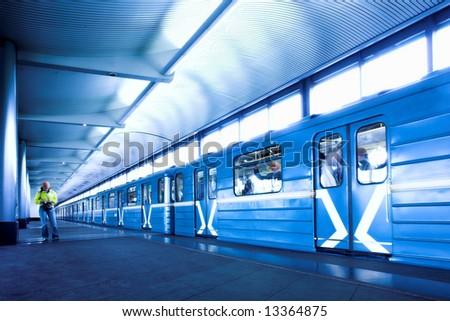 Blue train at subway hall platform - stock photo