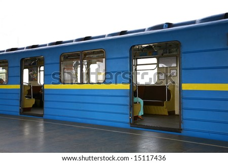Blue train at subway hall platform - stock photo