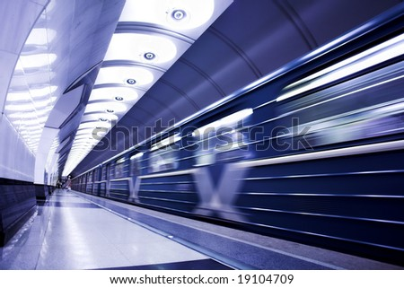 Blue train on platform in subway