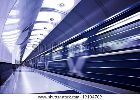 Blue train on platform in subway - stock photo
