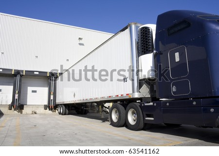 Blue Transport Truck Docking in warehouse