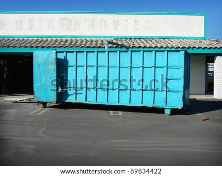 blue trash dumpster on construction site - stock photo