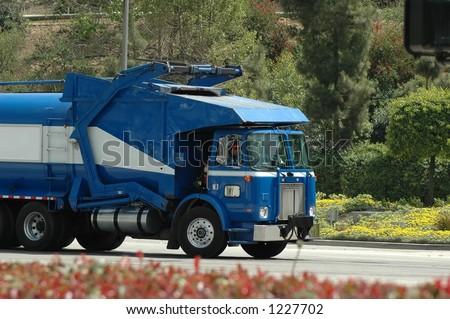 blue trash truck-front loader - stock photo