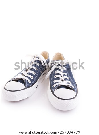 Blue trendy sport shoes on white background