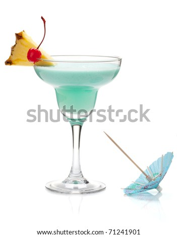 Blue tropical cocktail with pineapple and cherry. Isolated on white