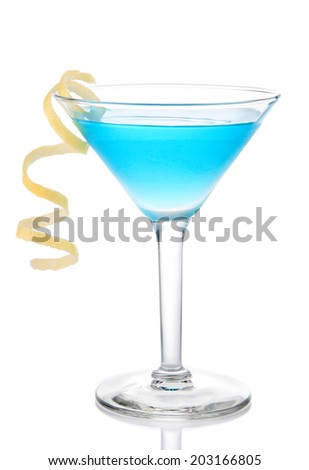 Blue tropical martini cocktail with yellow lemon spiral isolated on a white background - stock photo