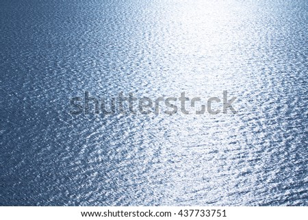 Blue tropical sea surface with waves and ripples on the top view
