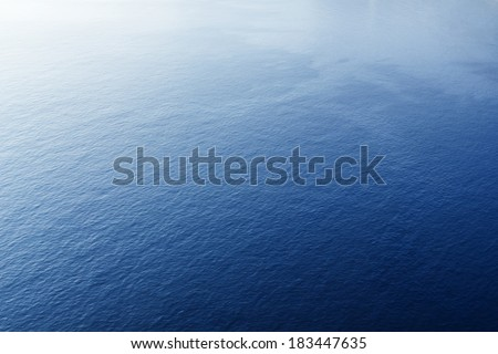 Blue tropical sea surface with waves and ripples. View from plane - stock photo