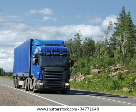 blue truck on country highway