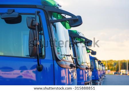 blue trucks in a row - stock photo