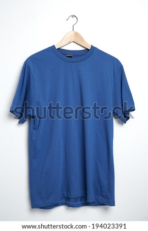Blue tshirt template on hanger ready for your own graphics. - stock photo