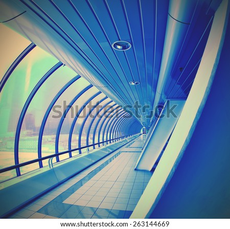 blue tunnel with glass wall. Moscow City, instagram image retro style - stock photo