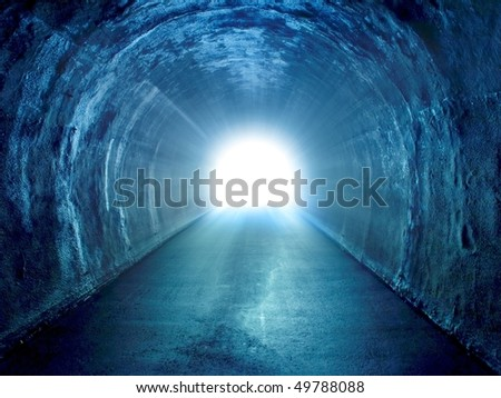Blue tunnel with light coming from the exit.