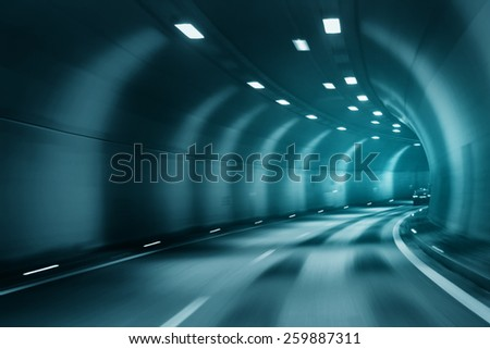 Blue turquoise color tunnel car driving motion blur.  - stock photo