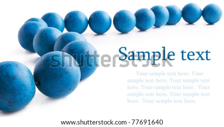 Blue turquoise necklace frame on white background with sample text - stock photo