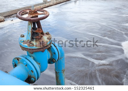 Blue valve gate for oxygen blowing in sewage water - stock photo