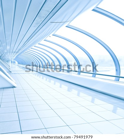 blue vanishing transparent hallway inside contemporary airport, transportation background - stock photo