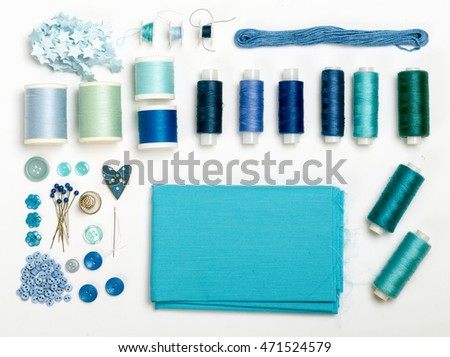 Blue various threads and sewing tools