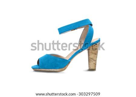 Blue velvet high heeded shoe on white background - stock photo