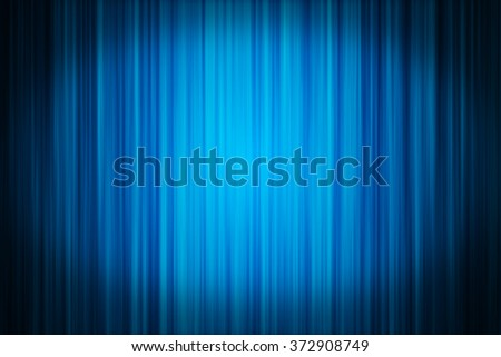 Blue velvet stage curtain  illuminated with a spotlight. Ideal to use as a background for various concepts.  - stock photo