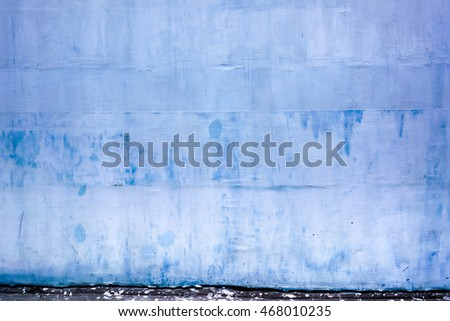 Blue vintage or grungy background of natural cement, stone or plaster with mesh backing. Blue old wall plaster texture with mesh backing as retro pattern layout or background. High quality resolution.