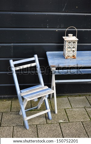 Blue vintage wooden chair and table - stock photo