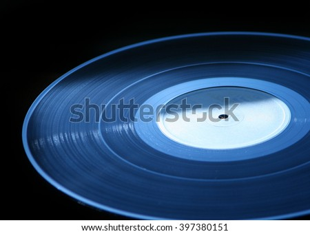 Blue vinyl record  turntable on dark background