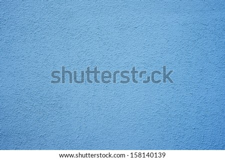 Blue wall of concrete with fines pores