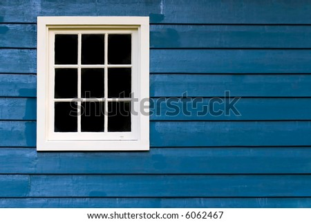 Blue wall with white window frame - stock photo