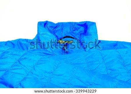 blue,warm light weight  insulated  jacket  on white background. - stock photo